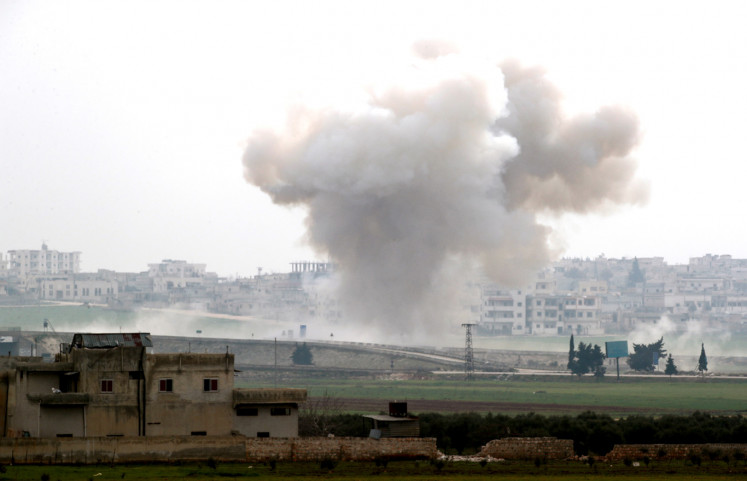 Smoke rises after an air strike in Saraqeb in Idlib province, Syria February 28, 2020.