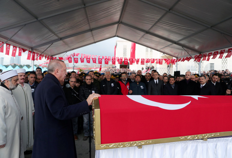 Turkey's President Tayyip Erdogan speaks during funeral ceremony of Turkish soldier Emre Baysal who was killed in Syria's Idlib region, in Istanbul, Turkey, February 29, 2020.