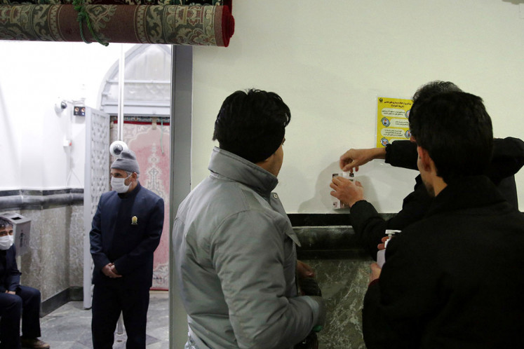 Pilgrims wash their hands before entering Imam Reza holy shrine, following the coronavirus outbreak, in Mashhad, Iran February 27, 2020. Picture taken February 27, 2020.