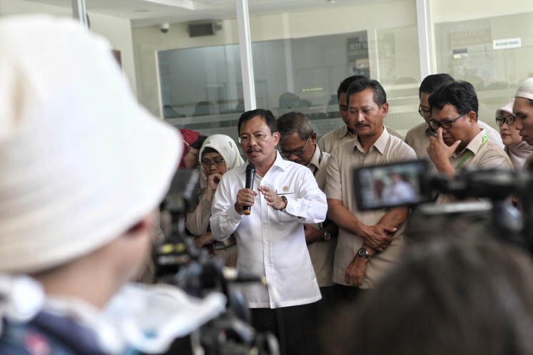 Health Minister Terawan Agus Putranto speaks to the press at Sulianti Saroso Infection Hospital (RSPI Sulianti Suroso) isolation building in Jakarta, Monday, March 2, 2020.The Minister of Health stated that two Indonesian citizens were positively affected by the corona virus and were currently in the isolation room of the RSPI Sulianti Saroso.