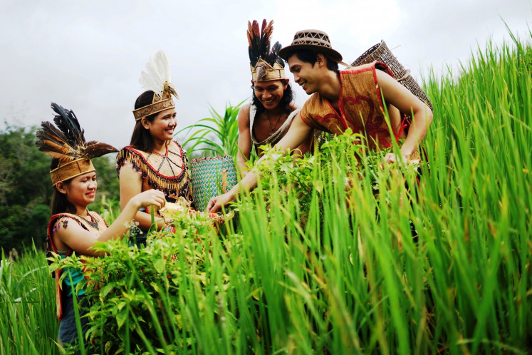 Green space: Some members of the Seberuang Ansok Traditional Youth Movement.