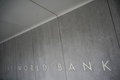 In this file photo taken on Jan. 17, 2019 The World Bank Group logo is seen on the building of the Washington-based global development lender in Washington,DC. (AFP/Eric Baradat).