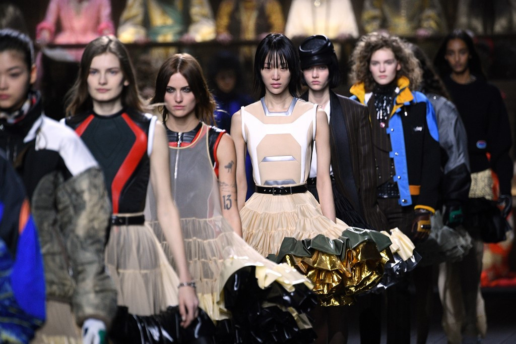 Vuitton hits high note with all-singing Paris fashion show
