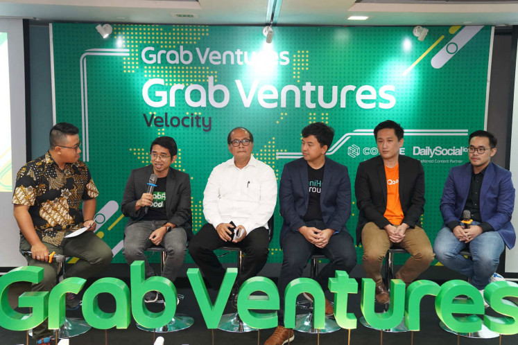 Success stories: Successful participants of previous batches of the Grab Ventures Velocity incubation program, including microinsurance provider Qoala cofounder and chief operating officer Tommy Martin (second right) and agricultural products distribution app TaniHub president and cofounder Pamitra Wineka (third right), share how Grab Indonesia's incubation program has helped them during a panel discussion.