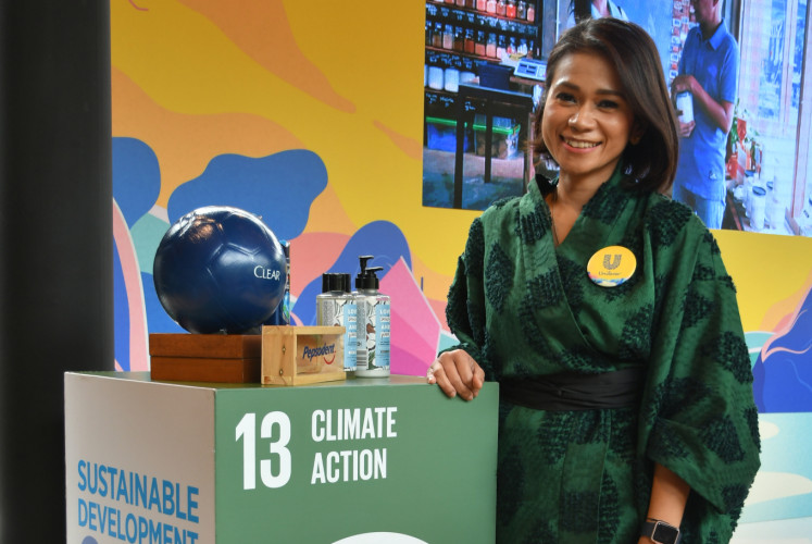 Nurdiana 'Ade' Darus, head of corporate affairs and sustainability of PT Unilever Indonesia, helps launch a refill station on Feb. 25 in Jakarta.