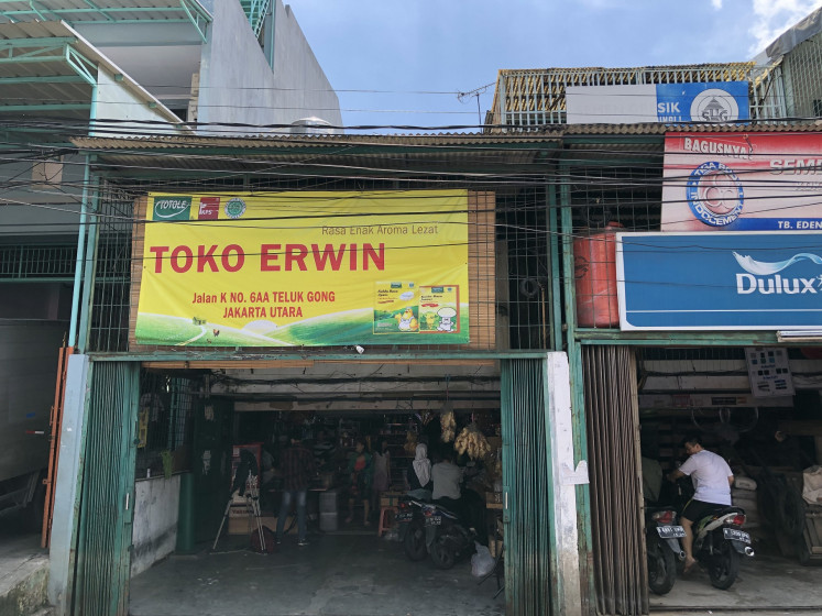 Erwin's grocery shop, which went viral on social media after its owners, Erwin and Susanna, limited excessive purchases of food amid coronavirus panic, is located in Teluk Gong, North Jakarta.