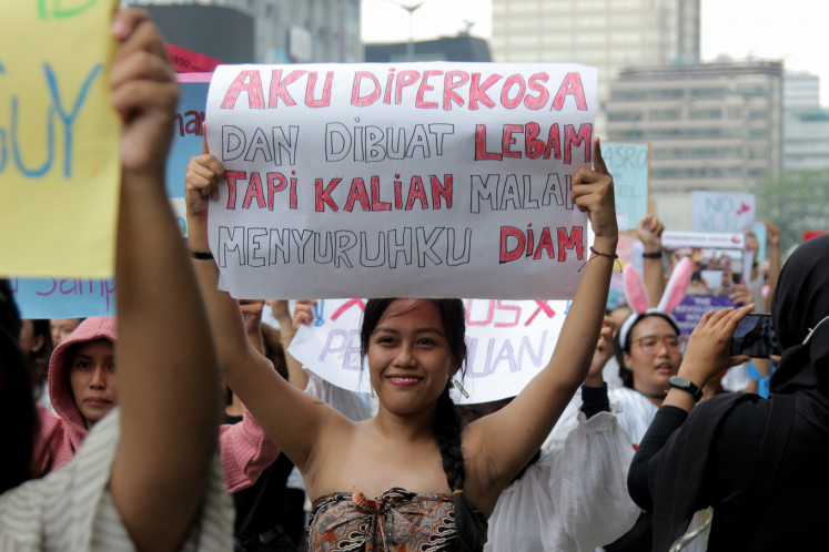 Women take part in the International Women's Day march in Sarinah, Central Jakarta, on March 8, 2020. The community demands gender equality rights on international women's day.
