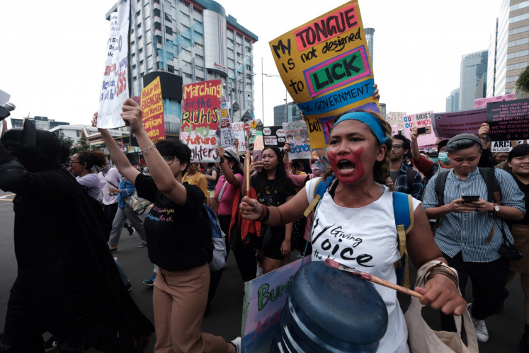 Women participate in the international women's day 2020 in Sarinah, Central Jakarta, on Sunday 8 March 2020.