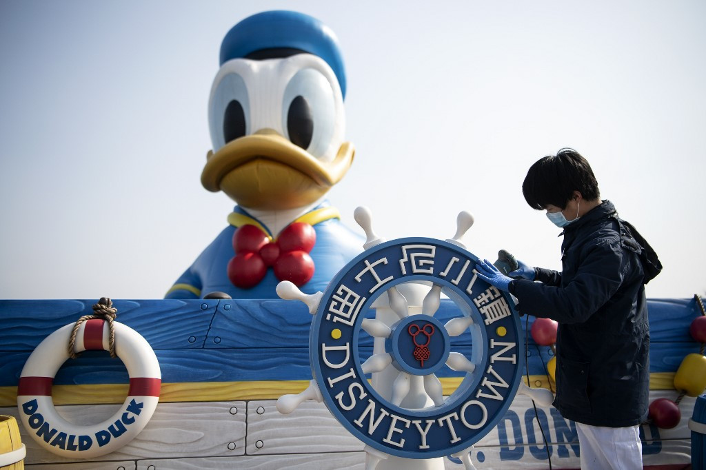China signals progress in virus battle as Disney partially reopens