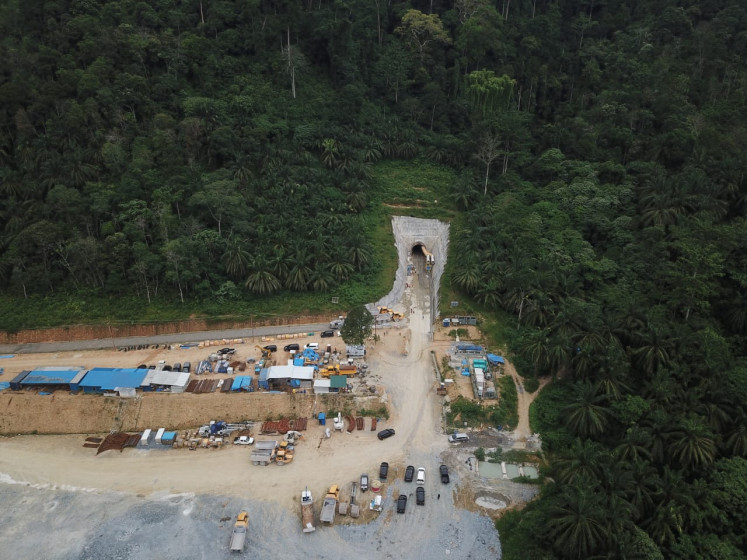 Construction workers dig an 8-kilometer headrace tunnel that will channel water from the Asahan River to the turbines of the Asahan III hydropower plant in North Sumatra.