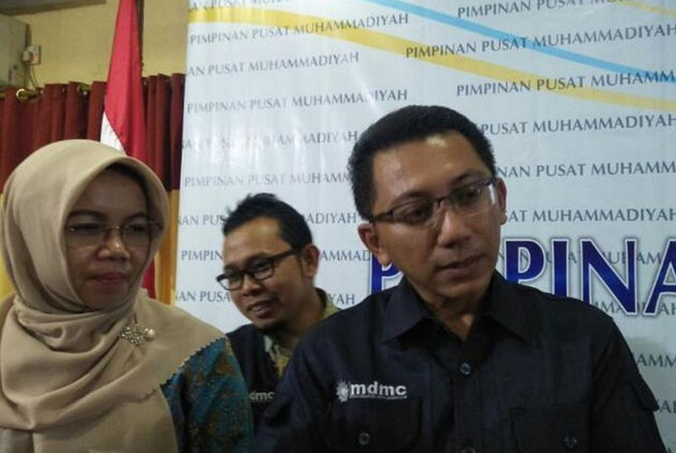 Indonesian physician, Corona Rintawan (right), is in-charge for the Muhammadiyah COVID-19 Command Center, which is aimed helping the government fight the spread of the COVID-19 coronavirus.