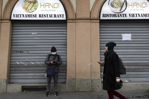 Italy shuts stores across country to fight virus
