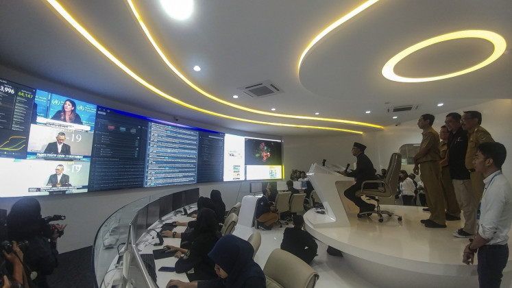 West Java Governor Ridwan Kamil (center) monitors information related to the spread of COVID-19 at the Command Center as well as the COVID-19 Information and Coordination Center in Bandung, West Java, Tuesday, March 10, 2020.