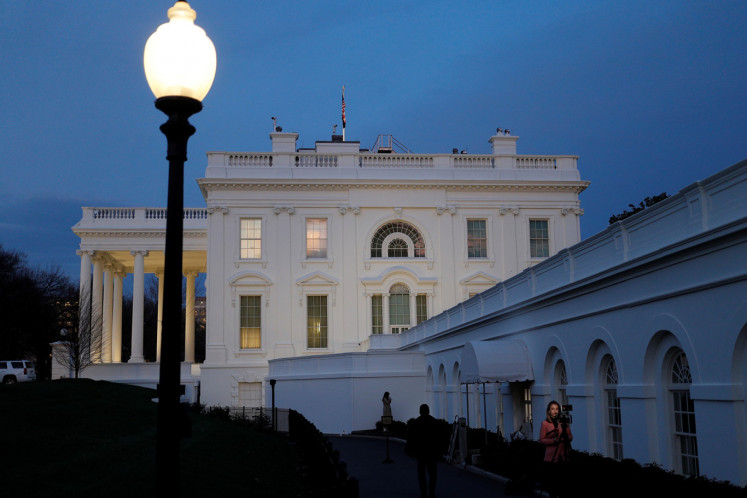 The White House at dusk ahead of U.S. President Donald Trump's address to the nation in Washington, U.S., March 11, 2020.