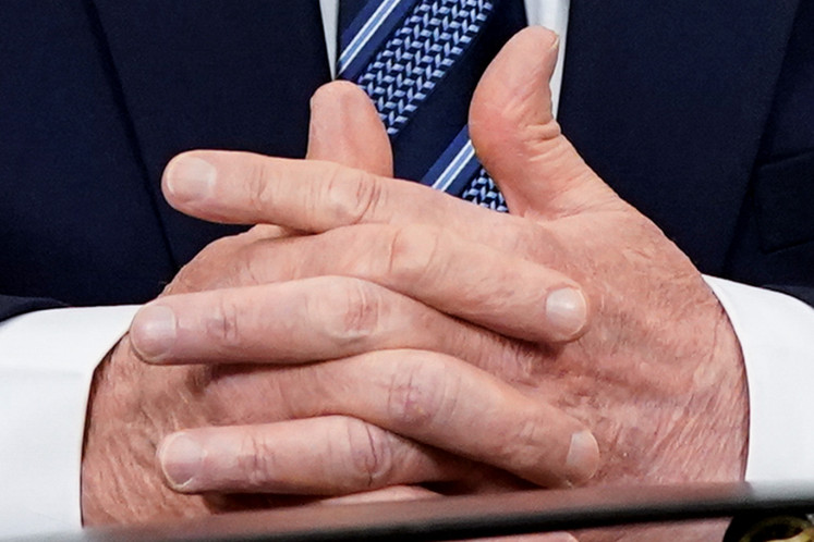 The hand gesture of U.S. President Donald Trump when he speaks about the U.S response to the COVID-19 coronavirus pandemic during an address to the nation from the Oval Office of the White House in Washington, U.S., March 11, 2020.