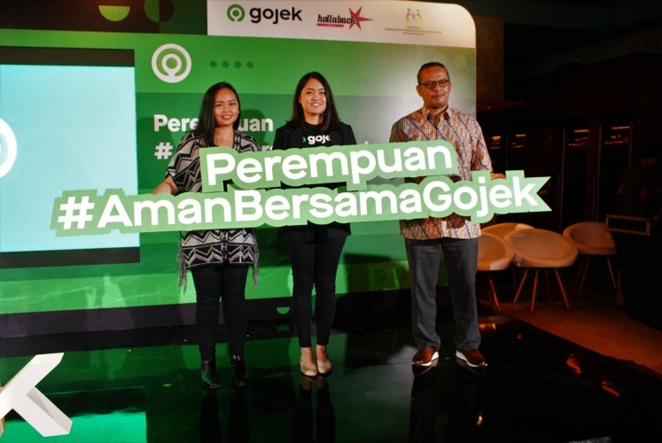 Codirector of Hollaback! Jakarta Anindya Restuviani (left), Gojek's senior vice president of transportation marketing Monita Moerdani (center) and public participation deputy head at the Women's Empowerment and Child Protection Ministry Indra Gunawan during the launch of #AmanBersamaGojek on March 11 in Jakarta.