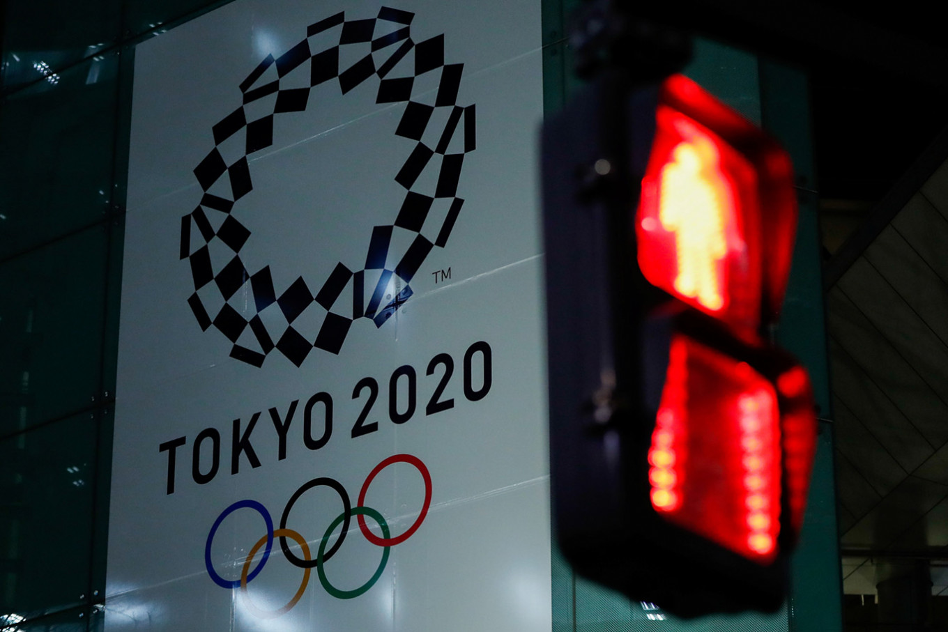 Japan says Olympics on track as Abe, Trump hold talks on coronavirus