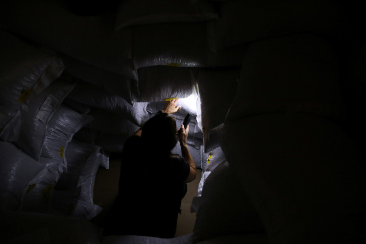 A Brazilian custom agent inspects the cargo inside a container going to Europe for smuggled drugs at the Port of Santos in Santos, Brazil September 23, 2019.