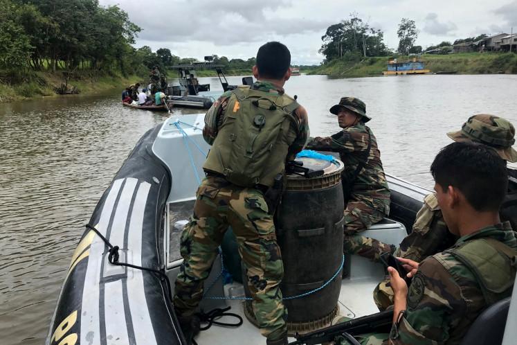 Peruvian anti-narcotics police officers patrol the Amazon river in Caballococha, Peru October 29, 2019.