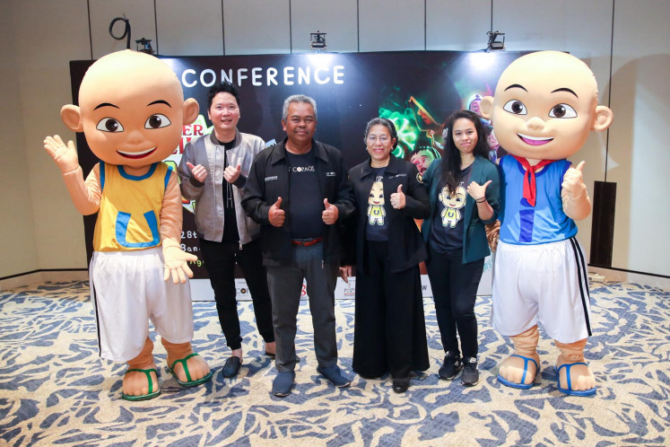 Keith of Biz Entertainment (left), managing director of Les' Copaque Production Haji Burhanuddin Md Radzi (second left), executive producer of Les' Copaque Production Hajah Ainon Ariff (second right) and creative content director of Les' Copaque Production Nur Naquyah Burhanuddin (right) during a press conference for 'Upin & Ipin PIN PIN POM!' on March 12 in South Jakarta.