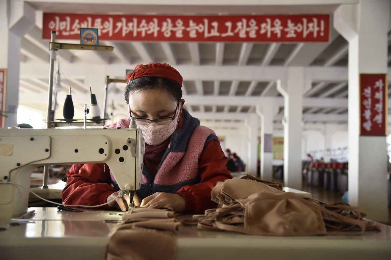 China says manufacturing activity expanded in March, defying expectations of a contraction
