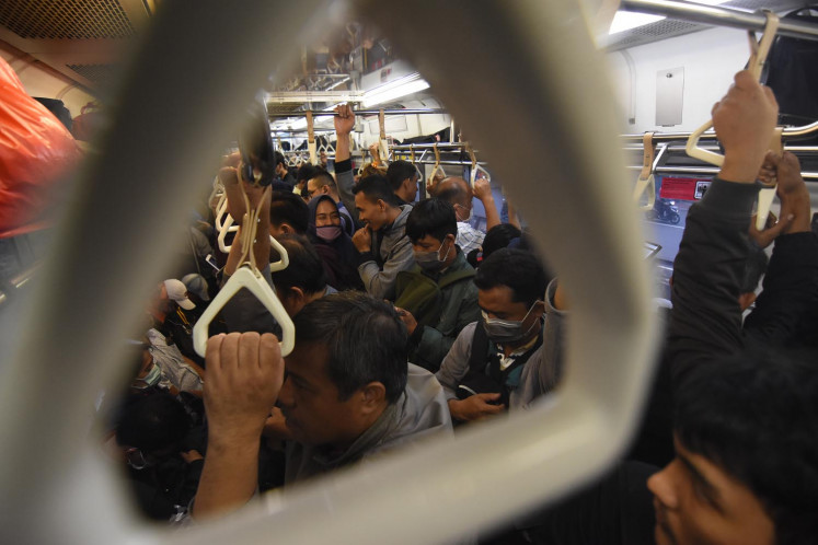 Commuters on a train from Jakarta to Bogor on March 12.