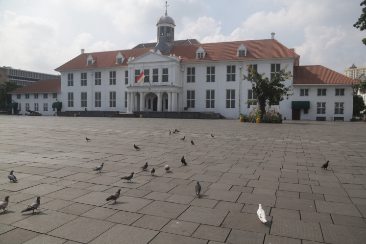 Pigeons roam Fatahillah Square in Kota Tua, West Jakarta, on March 15 after Jakarta Governor Anies Baswedan closed several tourist destinations on March 13.