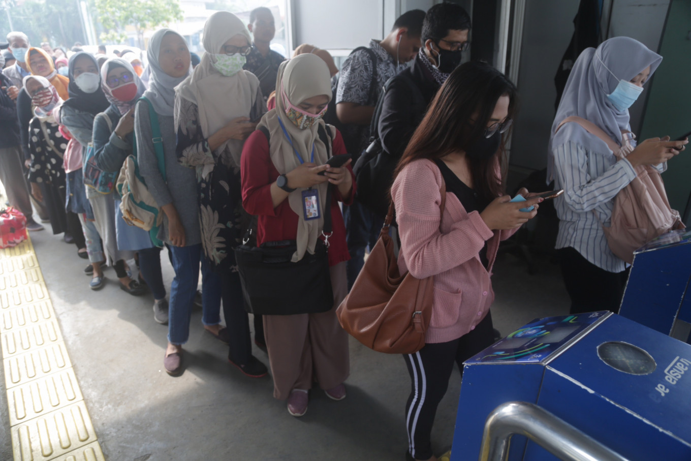 MRT, LRT and Transjakarta limit passenger numbers, but resume normal operating hours