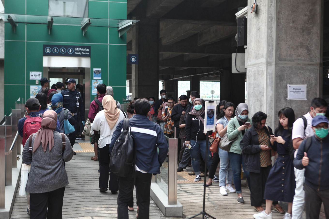 COVID-19: City-wide transport restrictions cause buildup at Transjakarta, MRT stations