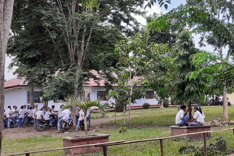 Vocational high school students in East Manggarai regency, East Nusa Tenggara, take a break at the school complex on March 16. The East Manggarai administration has not closed its schools, with the regent saying the area was safe from the coronavirus disease.