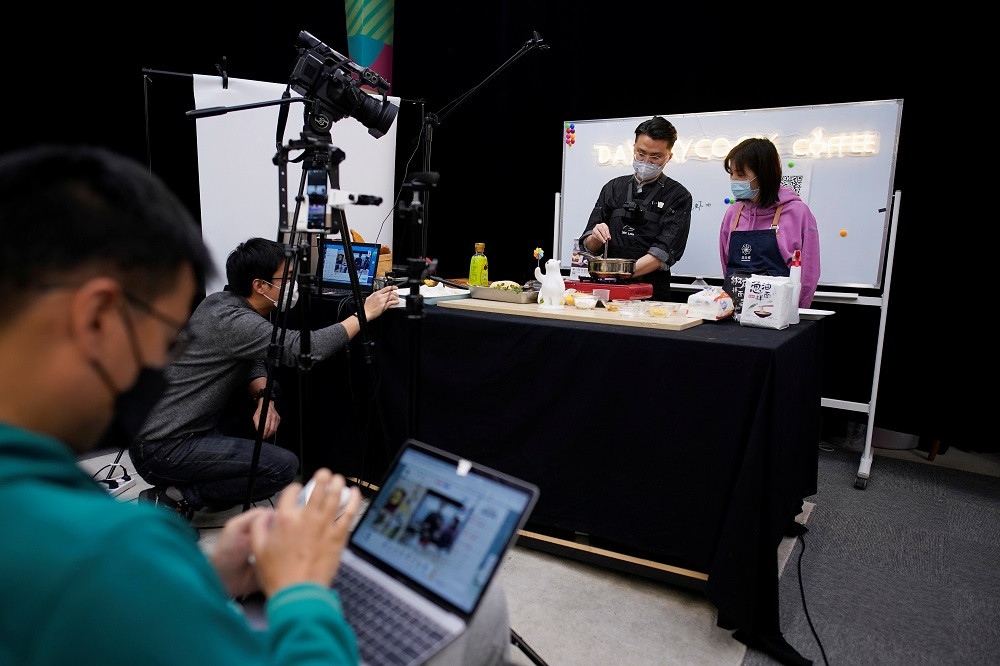 Cooped up by coronavirus, millions in China discover the joy of cooking