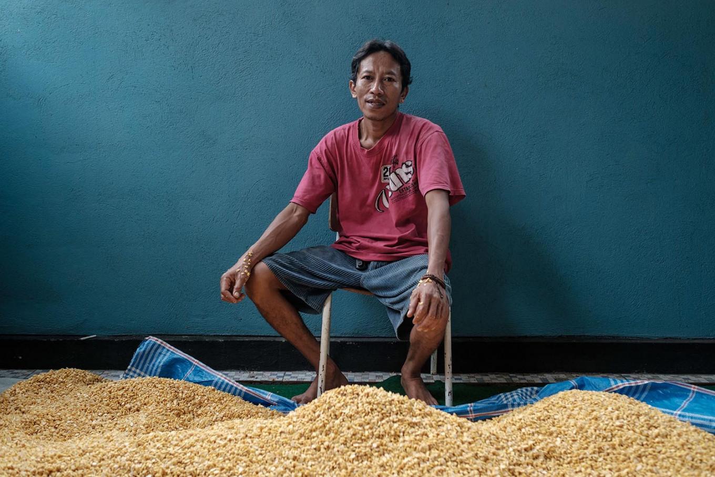 Tempe artisan Noerhakim, better known as Hakim, sits in front of piles of soybeans at his home in Singaraja, Buleleng regency, Bali. JP/ Anggara Mahendra