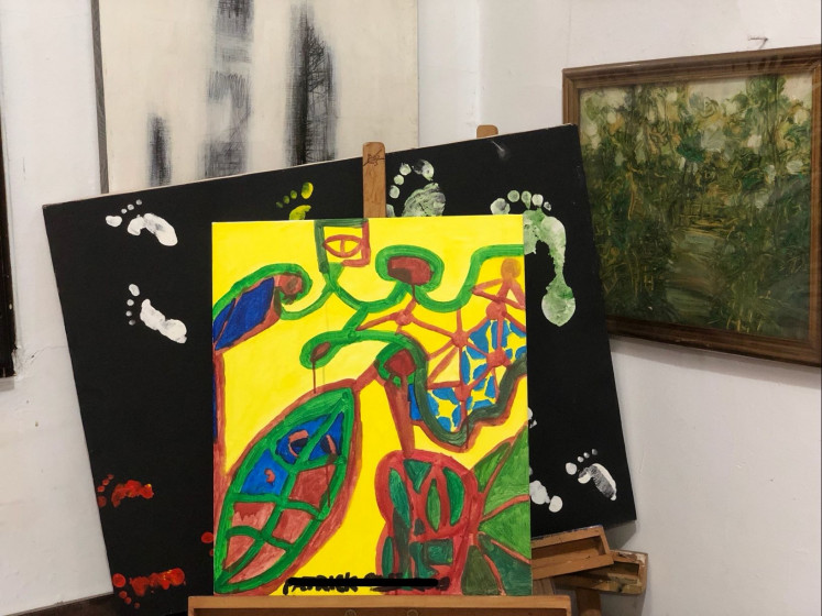Vibrant future: Artwork by a schizophrenic artist who currently volunteers for the Indonesian Care for Schizophrenia (KPSI) community depicts science illuminating the future.