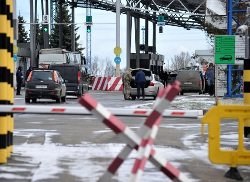 Ukraine shuts down transport, public spaces