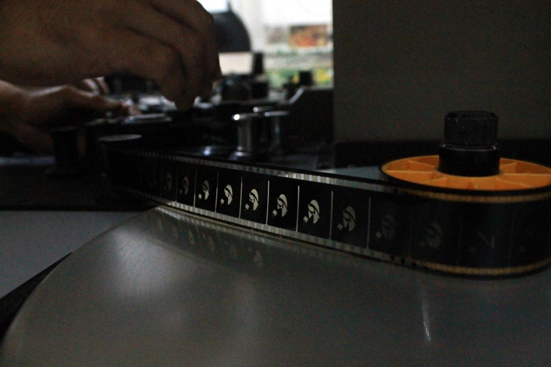 Analog technology: Celluloid film is threaded through an editing machine. JP/Xena Olivia