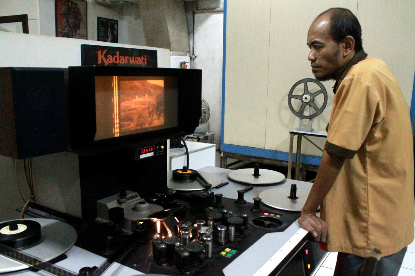 Quality control: Preservation technician Budi watches a cleaned movie reel looking for defects. JP/Xena Olivia
