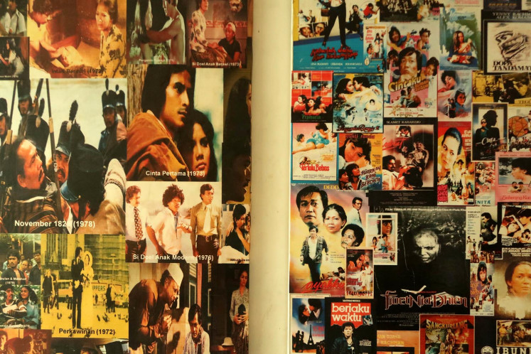All-time greats: A collage of posters and stills of classic Indonesian films adorns a wall at Sinematek Indonesia, the first film archive in Southeast Asia.