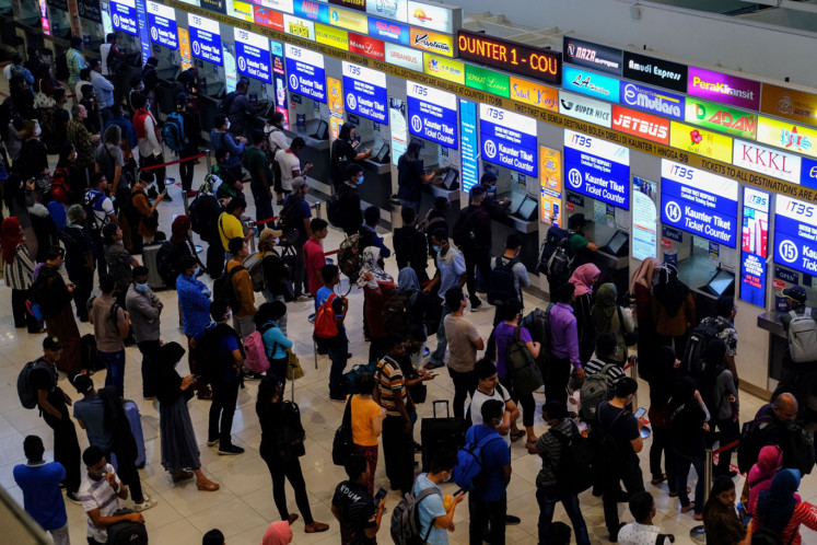 People line-up buy a ticket at the Terminal Bersepadu Selatan in Kuala Lumpur, Malaysia, on Tuesday, March. 17, 2020.