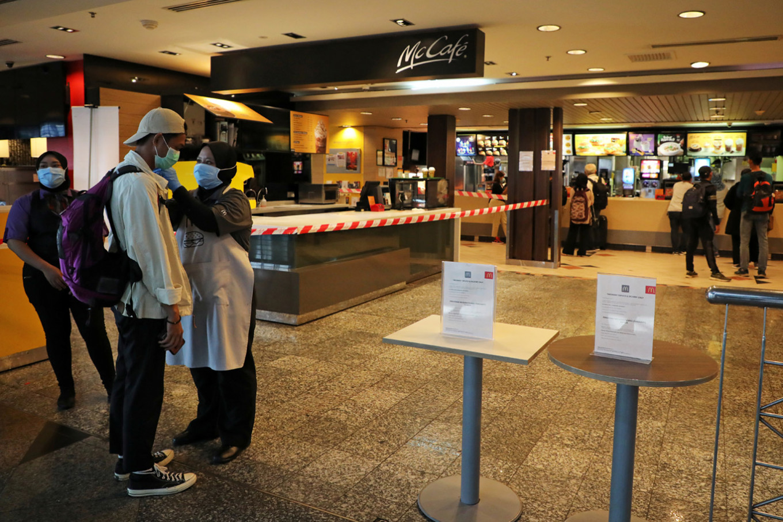 'Greater than a tsunami': Malaysia warns of coronavirus spread if curbs ignored