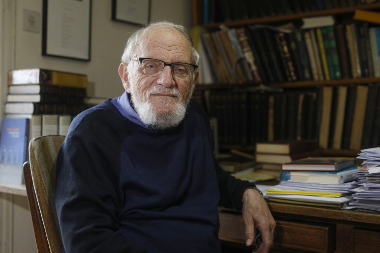 Israeli-American Hillel Furstenberg, who was awarded the Abel Prize for mathematics, poses for a picture at his house in Jerusalem on March 18, 2020.
