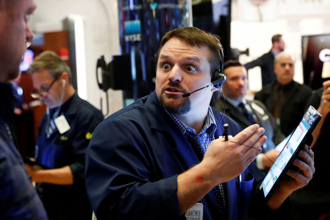 U.S. stocks end mixed amid anticipation of stimulus package