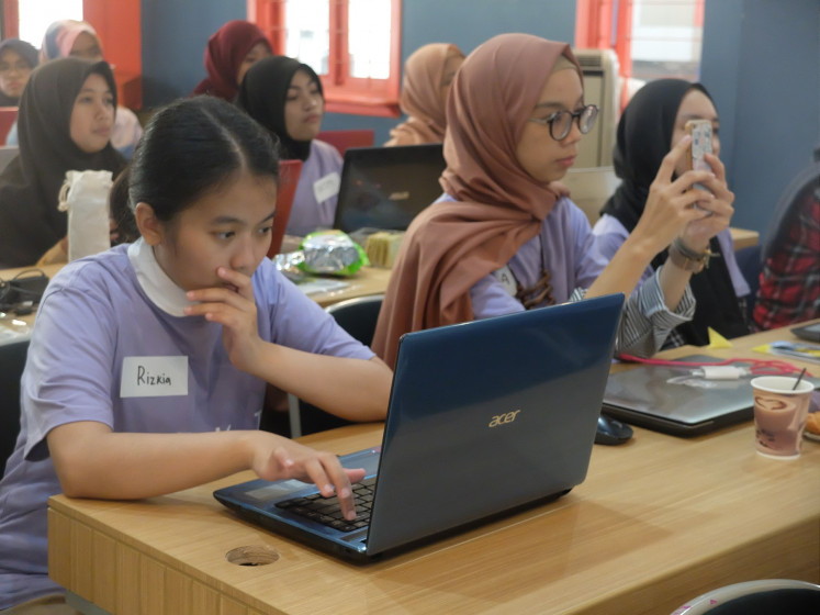 Laser focused: A participant is glued to her laptop during a recent Wikigap session in Bandung, west Java.