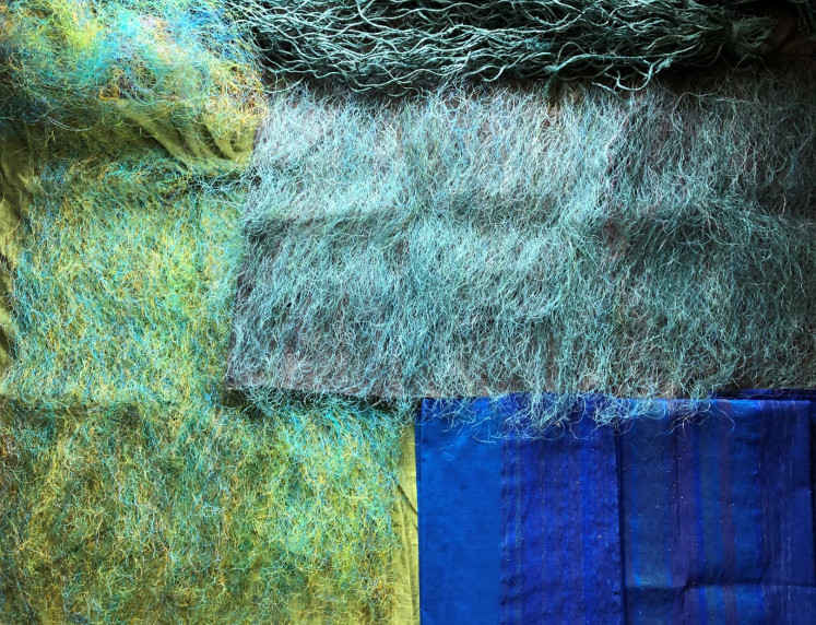 Artwork: For his work, titled 'The Ocean and The Mountain', Ari Bayuaji applies different techniques, from weaving, stitching to tying plastic threads to cotton fabric.