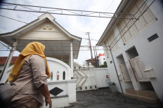 A woman walks inside the mosque complex. JP/Boy T Harjanto
