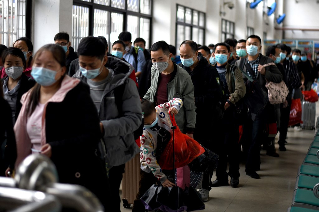 Lockdown lifted, but exodus from Chinese city hindered by new coronavirus test rule