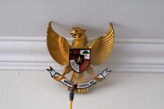 Indonesia's national emblem, the Garuda Pancasila, is sprayed with disinfectant liquid. JP/Fauzan