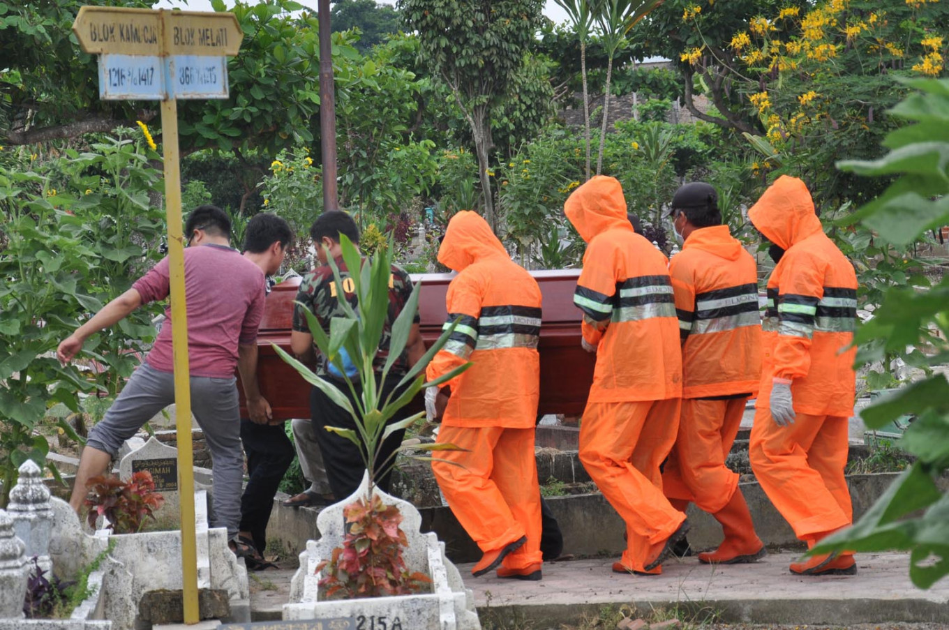 COVID-19: Tensions arise between residents, officials over burials in Depok, Medan