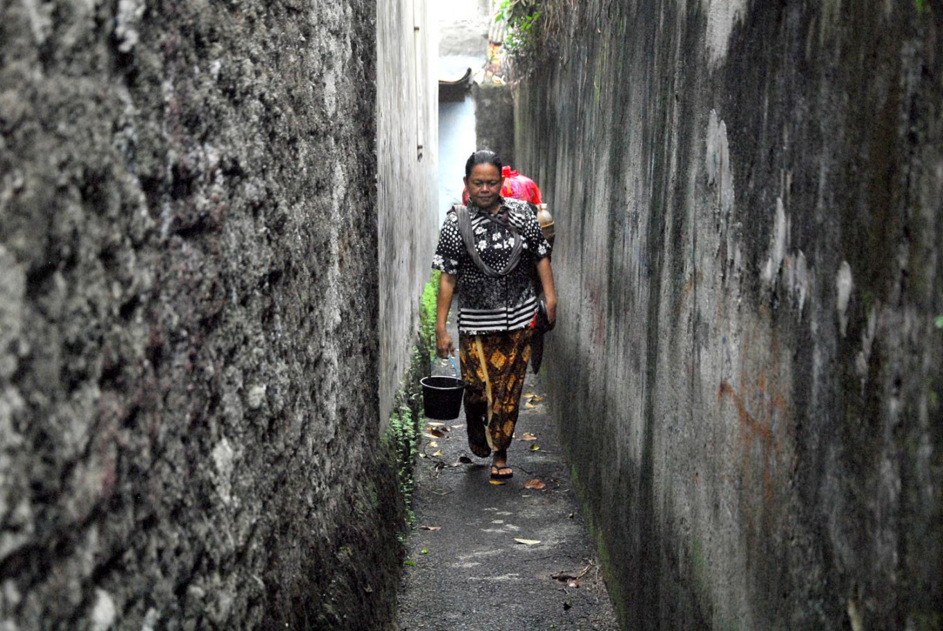 Handayani walks in a narrow alley in Pesanggrahan, South Jakarta. JP/Rahmat Dian Prasanto