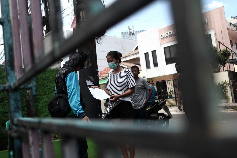 Regions start enforcing curfews to flatten Indonesia's COVID-19 curve