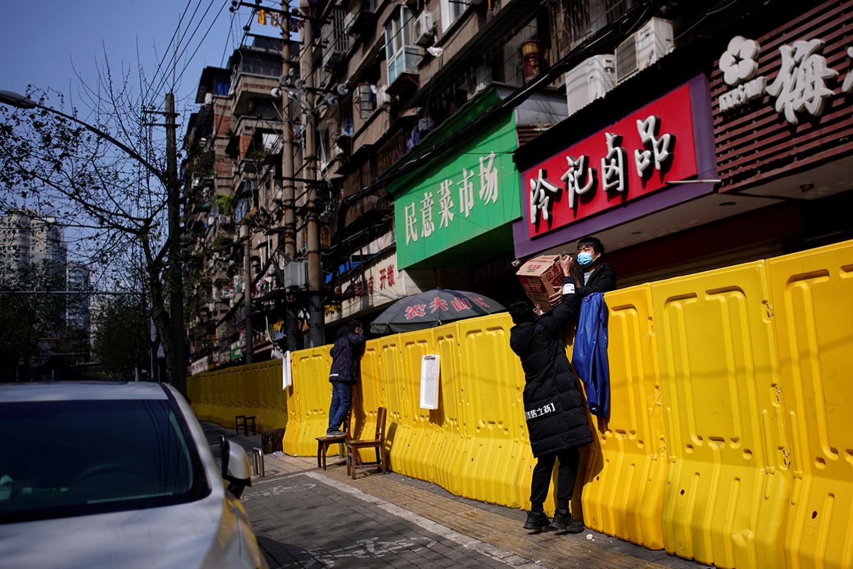 Wuhan's 'wet markets' struggle after virus lockdown